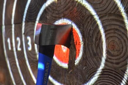 axe in bullseye of target